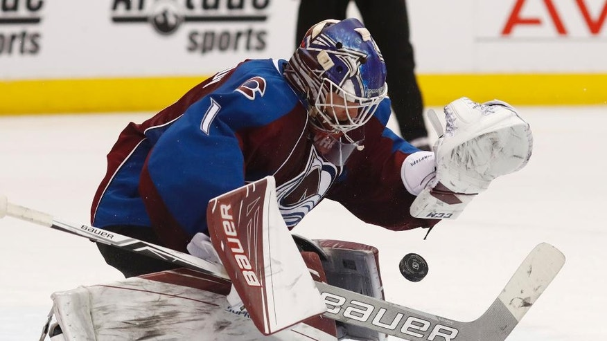 Colorado Avalanche goalie Semyon Varlamov, of Russia, struggles to stop a shot against the Columbus Blue Jackets in the second period of an NHL hockey game Thursday, Dec. 1, 2016, in Denver. (AP Photo/David Zalubowski)