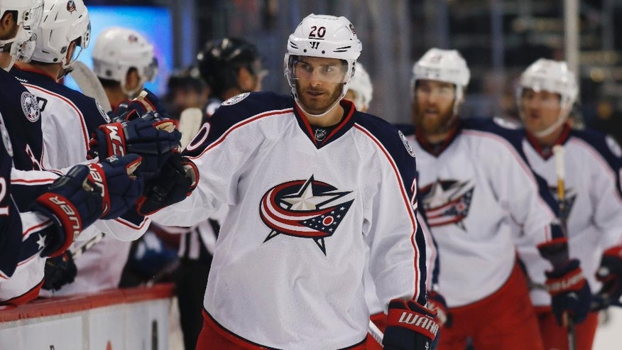 Columbus Blue Jackets left wing Brandon Saad, right, is congratulated as he passes the team box after scoring a goal against the Colorado Avalanche in the first period of an NHL hockey game Thursday, Dec. 1, 2016, in Denver. (AP Photo/David Zalubowski)