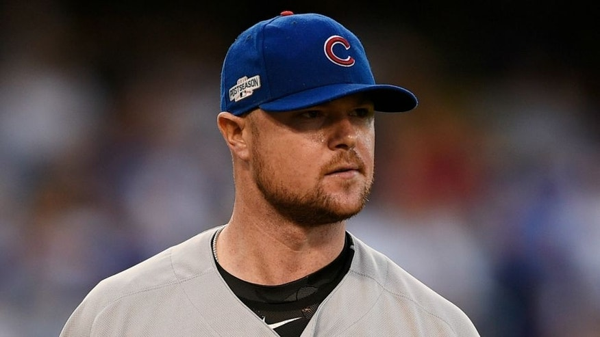 Oct 20, 2016; Los Angeles, CA, USA; Chicago Cubs starting pitcher Jon Lester (34) looks on in the first inning against the Chicago Cubs in game five of the 2016 NLCS playoff baseball series against the Los Angeles Dodgers at Dodger Stadium. Mandatory Credit: Kelvin Kuo-USA TODAY Sports