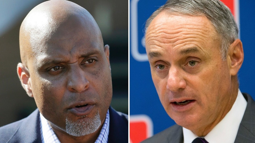 Major League Baseball Players Association executive and former Detroit Tigers first baseman Tony Clark, left, and Commissioner Rob Manfred.