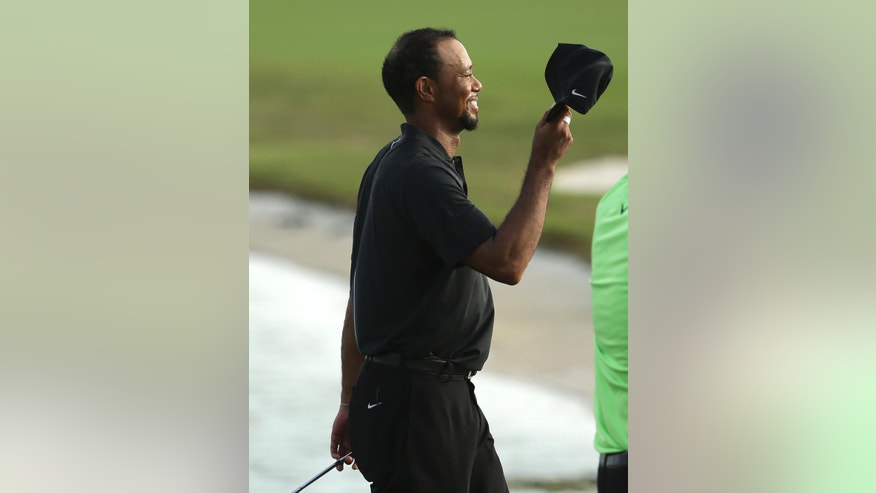 Tiger Woods walks off the 18th green after the first round at the Hero World Challenge golf tournament, Thursday, Dec. 1, 2016, in Nassau, Bahamas. Woods is one-over-par for the round. (AP Photo/Lynne Sladky)