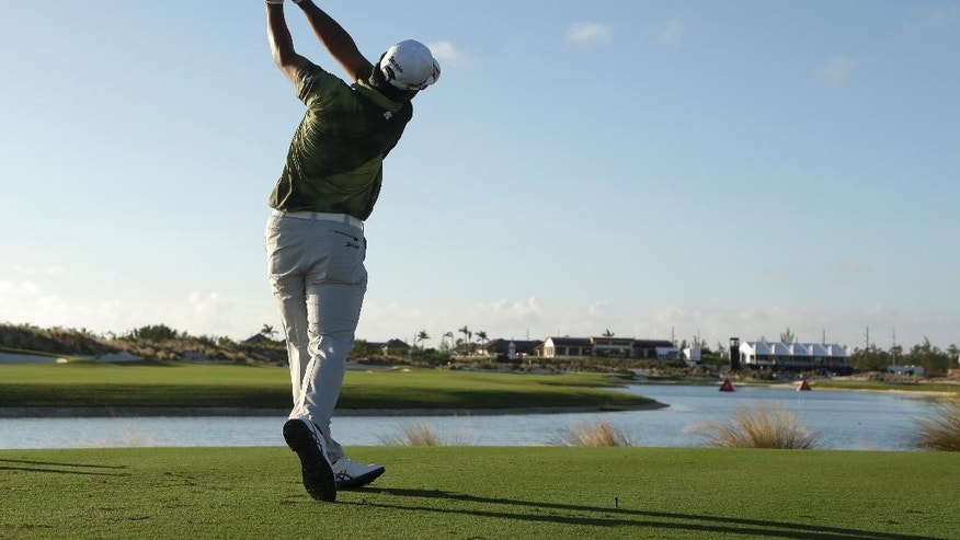 Hideki Matsuyama, of Japan, tees off on the 18th hole during the second round at the Hero World Challenge golf tournament, Friday, Dec. 2, 2016, in Nassau, Bahamas. (AP Photo/Lynne Sladky)