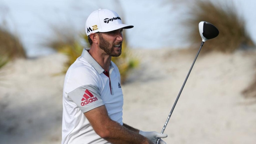 Dustin Johnson watches his tee shot on the 16th hole during the second round at the Hero World Challenge golf tournament, Friday, Dec. 2, 2016, in Nassau, Bahamas. (AP Photo/Lynne Sladky)