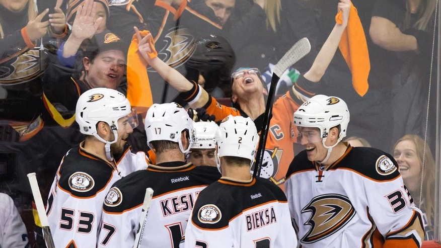 Anaheim Ducks' Shea Theodore, Ryan Kesler, Andrew Cogliano, Kevin Bieksa and Jakob Silfverberg, of Sweden, from left, celebrate Cogliano's goal against the Vancouver Canucks during the third period of an NHL hockey game Thursday, Dec. 1, 2016, in Vancouver, British Columba. (Darryl Dyck/The Canadian Press via AP)