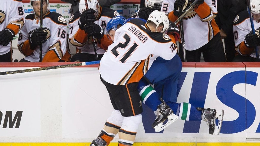 Anaheim Ducks' Chris Wagner (21) checks Vancouver Canucks' Troy Stecher during the third period of an NHL hockey game Thursday, Dec. 1, 2016, in Vancouver, British Columba. (Darryl Dyck/The Canadian Press via AP)