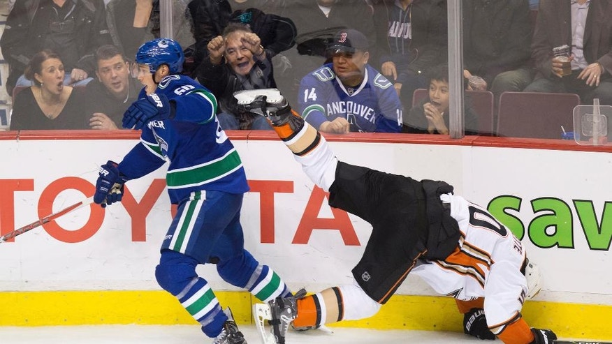 Anaheim Ducks' Antoine Vermette, right, is sent flying after colliding with Vancouver Canucks' Brendan Gaunce during the third period of an NHL hockey game Thursday, Dec. 1, 2016, in Vancouver, British Columba. (Darryl Dyck/The Canadian Press via AP)