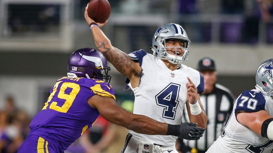 Dec 1, 2016; Minneapolis, MN, USA; Dallas Cowboys quarterback Dak Prescott (4) passes under the pressure of Minnesota Vikings defensive end Danielle Hunter (99) in the fourth quarter at U.S. Bank Stadium. The Cowboys win 17-15. Mandatory Credit: Bruce Kluckhohn-USA TODAY Sports