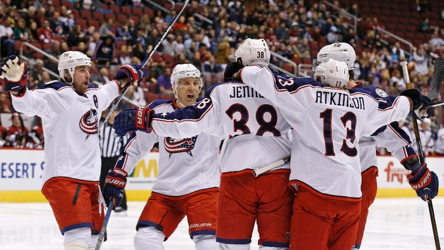 Columbus Blue Jackets center Boone Jenner (38) celebrates his goal against the Arizona Coyotes with center Brandon Dubinsky, left, defenseman Jack Johnson, second from left, right wing Cam Atkinson (13) and defenseman David Savard, right, during the first period of an NHL hockey game Saturday, Dec. 3, 2016, in Glendale, Ariz. (AP Photo/Ross D. Franklin)