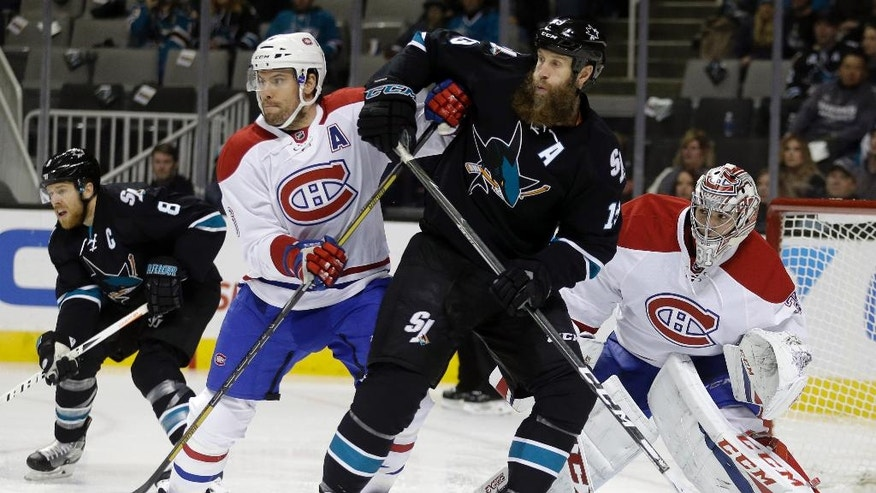 Montreal Canadiens' Shea Weber, front left, and goalie Carey Price, right, defend San Jose Sharks' Joe Thornton (19) during the first period of an NHL hockey game Friday, Dec. 2, 2016, in San Jose, Calif. At left is Sharks' Joe Pavelski (8). (AP Photo/Ben Margot)