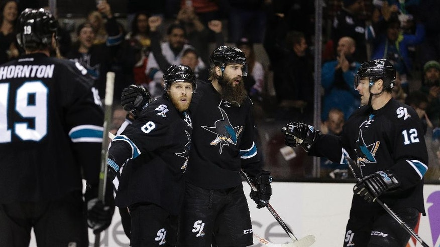 San Jose Sharks' Brent Burns, center right, celebrates with Joe Thornton (19), Joe Pavelski (8) and Patrick Marleau (12) after scoring a goal against the Montreal Canadiens during the first period of an NHL hockey game Friday, Dec. 2, 2016, in San Jose, Calif. (AP Photo/Ben Margot)