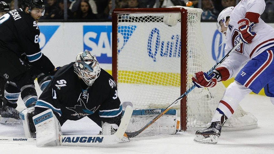 Montreal Canadiens' Brendan Gallagher, right, takes a shot against San Jose Sharks goalie Martin Jones (31) during the second period of an NHL hockey game Friday, Dec. 2, 2016, in San Jose, Calif. At left is Sharks' Joe Pavelski (8). (AP Photo/Ben Margot)