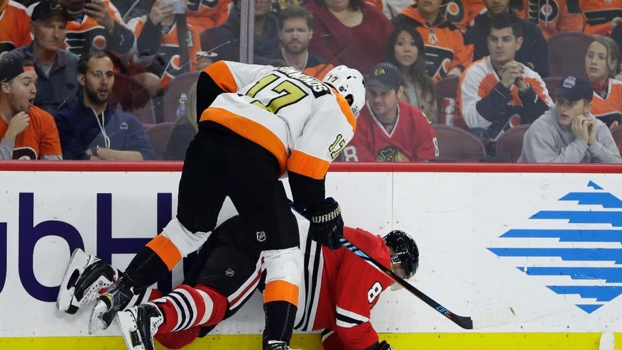 Philadelphia Flyers' Wayne Simmonds (17) collides with Chicago Blackhawks' Marian Hossa (81) during the second period of an NHL hockey game, Saturday, Dec. 3, 2016, in Philadelphia. (AP Photo/Matt Slocum)