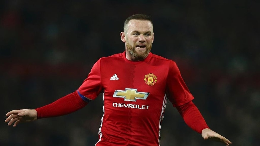 Manchester United's Wayne Rooney reacts after missing a chance to score a goal during the English League Cup quarterfinal soccer match between manchester United and West Ham United at Old Trafford in Manchester, England Wednesday, Nov. 30, 2016. (AP Photo/Dave Thompson)