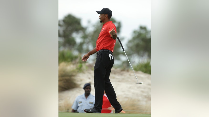 Tiger Woods drops his club after missing a putt on the third hole during the final round at the Hero World Challenge golf tournament, Sunday, Dec. 4, 2016, in Nassau, Bahamas. (AP Photo/Lynne Sladky)