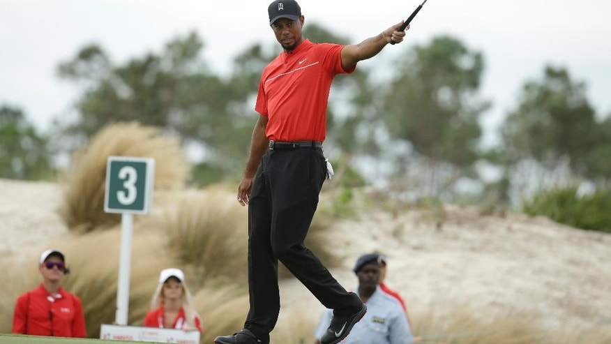 Tiger Woods reacts after putting on the third hole during the final round at the Hero World Challenge golf tournament, Sunday, Dec. 4, 2016, in Nassau, Bahamas. (AP Photo/Lynne Sladky)