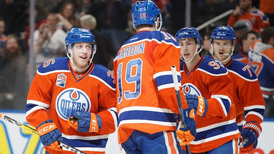 Edmonton Oilers' Drake Caggiula (36), Patrick Maroon (19), Ryan Nugent-Hopkins (93) and Oscar Klefbom (77) celebrate a goal against the Anaheim Ducks during the second period of an NHL hockey game Saturday, Dec. 3, 2016, in Edmonton, Alberta. (Jason Franson/The Canadian Press via AP)