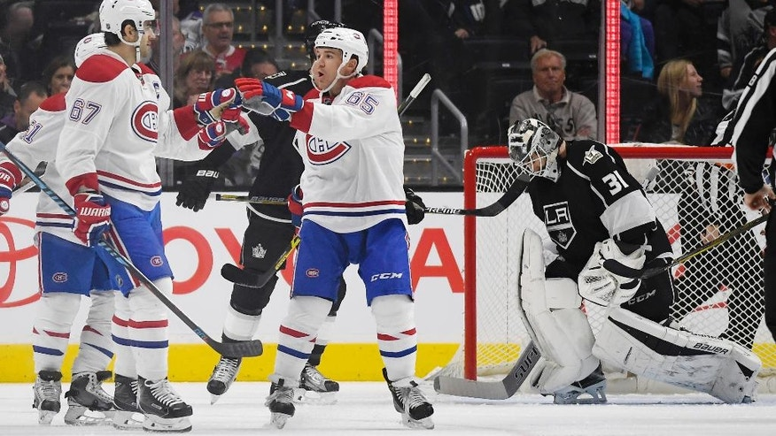 Montreal Canadiens left wing Max Pacioretty, left, celebrates his goal with center Andrew Shaw, center, as Los Angeles Kings goalie Peter Budaj, of Slovakia, gets up from the ice during the second period of an NHL hockey game, Sunday, Dec. 4, 2016, in Los Angeles. (AP Photo/Mark J. Terrill)
