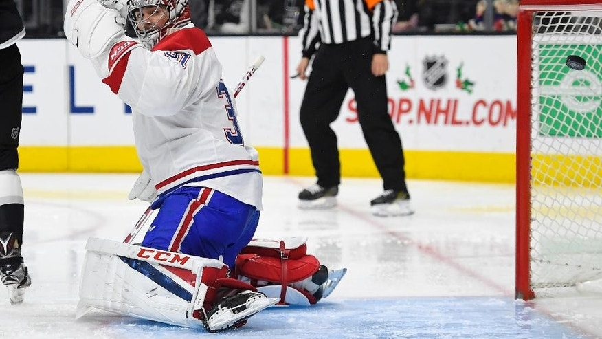 Montreal Canadiens goalie Carey Price is scored on by Los Angeles Kings center Jeff Carter during the second period of an NHL hockey game, Sunday, Dec. 4, 2016, in Los Angeles. (AP Photo/Mark J. Terrill)