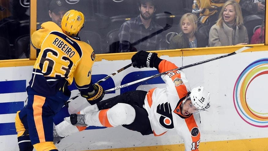 Nashville Predators center Mike Ribeiro (63) collies with Philadelphia Flyers defenseman Michael Del Zotto (15) during the third period of an NHL hockey game Sunday, Dec. 4, 2016, in Nashville, Tenn. The Flyers won 4-2. (AP Photo/Mark Zaleski)