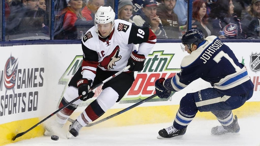Arizona Coyotes' Shane Doan, left, controls the puck as Columbus Blue Jackets' Jack Johnson defends during the third period of an NHL hockey game Monday, Dec. 5, 2016, in Columbus, Ohio. The Blue Jackets defeated the Coyotes 4-1. (AP Photo/Jay LaPrete)