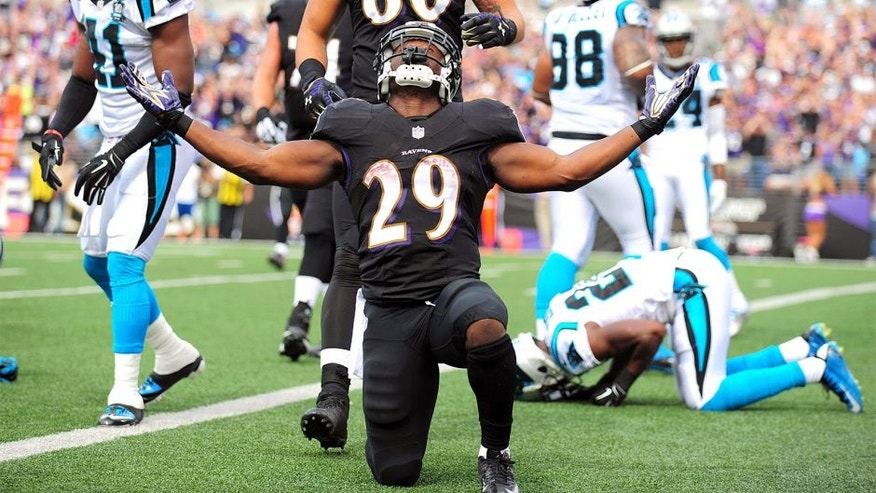 Sep 28, 2014; Baltimore, MD, USA; Baltimore Ravens running back Justin Forsett (29) celebrates after scoring a touchdown in the second quarter against the Carolina Panthers at M&T Bank Stadium. Mandatory Credit: Evan Habeeb-USA TODAY Sports