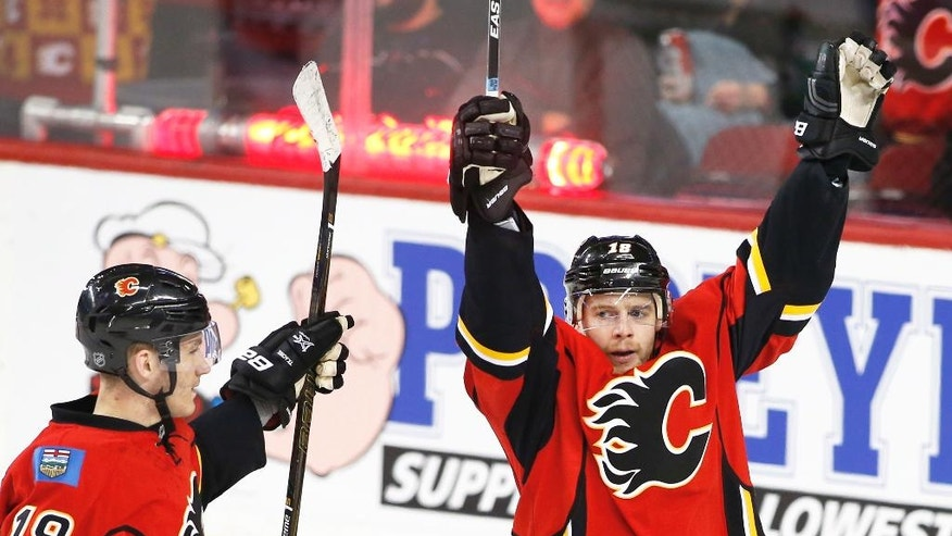 Calgary Flames' Matt Stajan, right, celebrates his goal with Matthew Tkachuk against the Anaheim Ducks during the second period of an NHL game in Calgary, Alberta, Sunday, Dec. 4, 2016. (Larry MacDougal/The Canadian Press via AP)