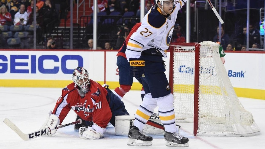 Buffalo Sabres center Derek Grant (27) celebrates the goal scored by Buffalo Sabres center Zemgus Girgensons (not shown) in front of Washington Capitals goalie Braden Holtby (70) during first period of an NHL hockey game, Monday, Dec. 5, 2016, in Washington. (AP Photo/Molly Riley)