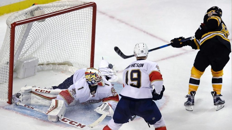 Boston Bruins right wing David Pastrnak, right, shoots his game-winning goal over Florida Panthers goalie Roberto Luongo (1) during the overtime period of an NHL hockey game in Boston, Monday, Dec. 5, 2016. The Bruins won 4-3. At right is Panthers defenseman Michael Matheson. (AP Photo/Charles Krupa)
