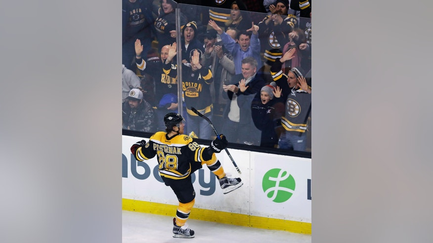 Boston Bruins right wing David Pastrnak (88) celebrates his game-winning goal against the Florida Panthers during the overtime period of an NHL hockey game in Boston, Monday, Dec. 5, 2016. (AP Photo/Charles Krupa)