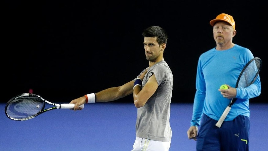 "FILE - In this Jan. 14, 2016, file photo, Serbia's Novak Djokovic, right, walks with his coach Boris Becker during a training session on Rod Laver Arena ahead of the Australian Open tennis championships in Melbourne, Australia. Djokovic says he and coach Boris Becker are splitting up after three seasons together. Djokovic posted a statement on Facebook on Tuesday, Dec. 6, 2016, saying the duo ""jointly decided to end our cooperation.""(AP Photo/Mark Baker, File)"