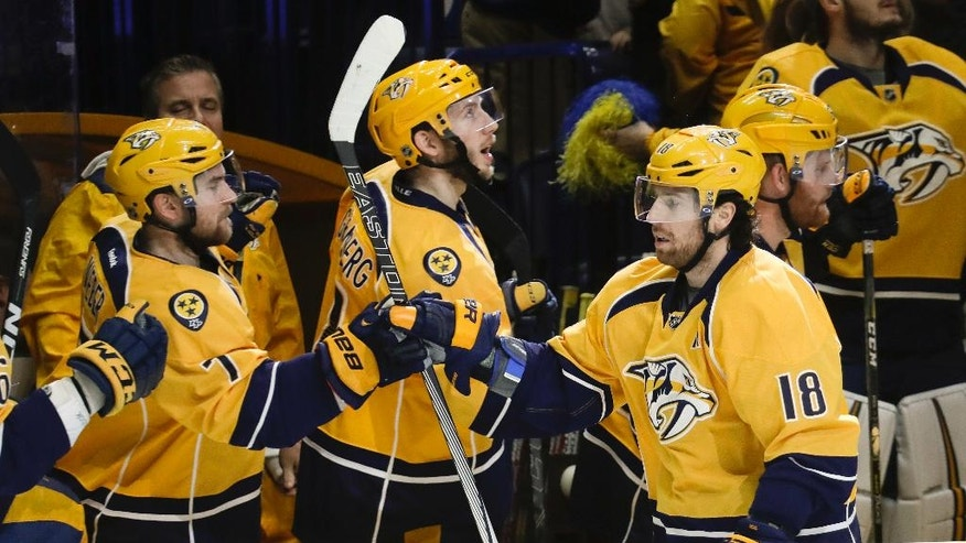 Nashville Predators right wing James Neal (18) is congratulated by teammates after scoring a goal against the Colorado Avalanche during the first period of an NHL hockey game, Tuesday, Dec. 6, 2016, in Nashville, Tenn. (AP Photo/Mark Humphrey)