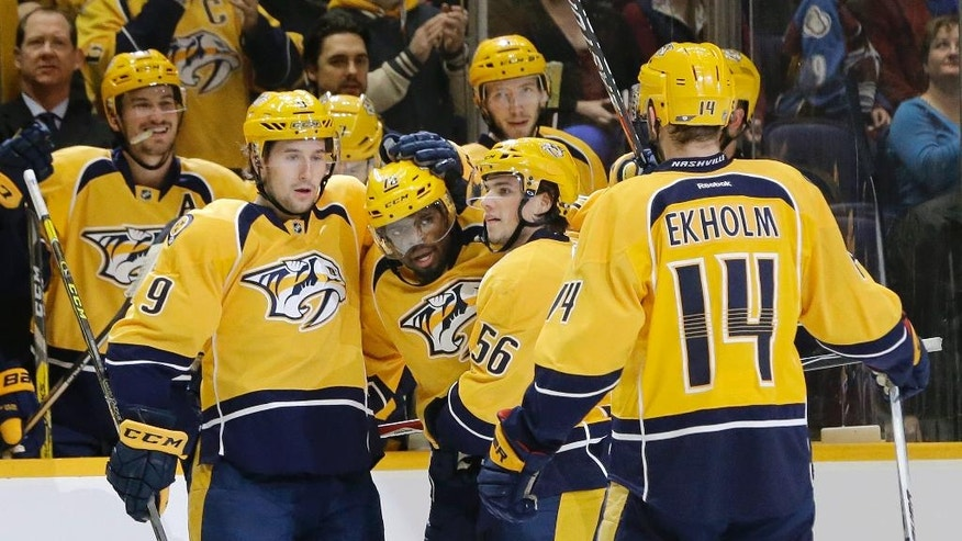 Nashville Predators defenseman P.K. Subban (76), center, celebrates with Filip Forsberg (9), of Sweden, Kevin Fiala (56), of Switzerland, and Mattias Ekholm (14), of Sweden, after Subban scored a goal against the Colorado Avalanche during the second period of an NHL hockey game Tuesday, Dec. 6, 2016, in Nashville, Tenn. (AP Photo/Mark Humphrey)