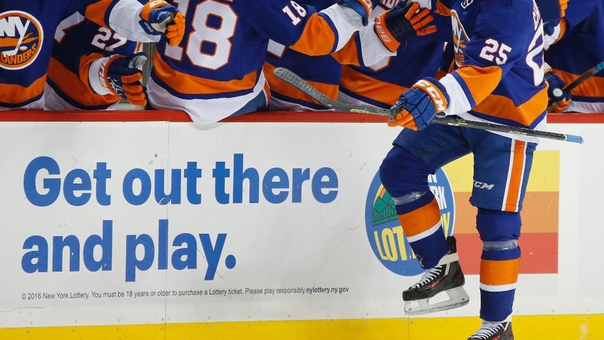 New York Islanders' left wing Jason Chimera (25) reacts as he greets teammates on the bench after scoring a goal during the first period of an NHL hockey game against the New York Rangers, Tuesday, Dec. 6, 2016, in New York. (AP Photo/Kathy Willens)