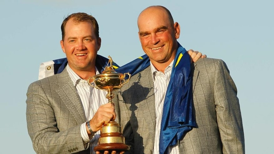 FILE - In this Monday, Oct. 4, 2010 file photo, Europe's Peter Hanson, left, and assistant captain Thomas Bjorn hold the trophy after Europe won the 2010 Ryder Cup golf tournament at the Celtic Manor Resort in Newport, Wales. Bjorn is the first Scandinavian to be appointed captain of Europe's Ryder Cup team. The 45-year-old Dane will lead the team against the United States in 2018 at Le Golf National in Paris after being chosen by a five-man panel, including Europe's past three captains.   (AP Photo/Jon Super, File)