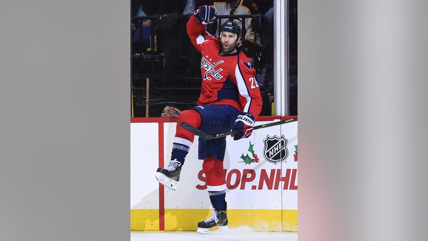 Washington Capitals left wing Daniel Winnik (26) celebrates his goal against the Boston Bruins during second period of an NHL hockey game, Wednesday, Dec. 7, 2016, in Washington. (AP Photo/Molly Riley)