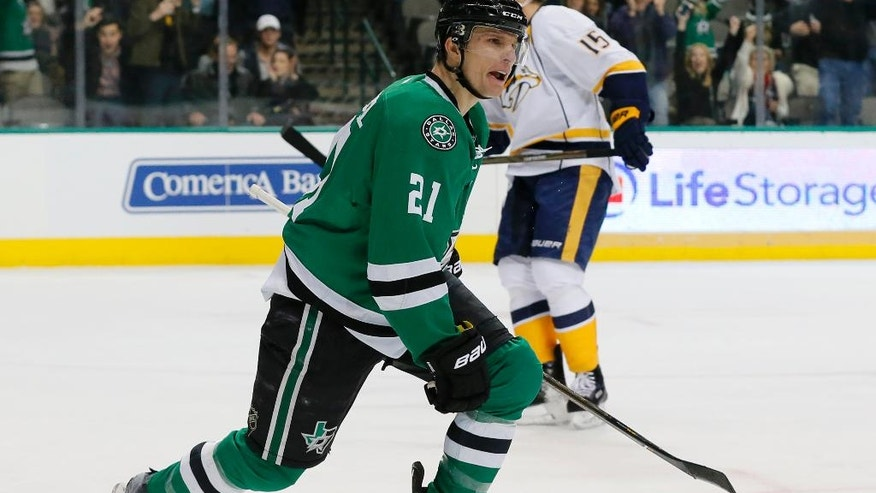 Dallas Stars left wing Antoine Roussel (21) of France celebrates a goal by right wing Brett Ritchie as Nashville Predators' Craig Smith (15) skates away in the first period of an NHL hockey game, Thursday, Dec. 8, 2016, in Dallas. Roussel had the assist on the score. (AP Photo/Tony Gutierrez)