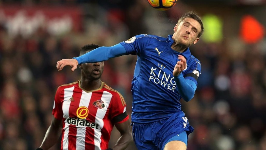 Leicester City's Jamie Vardy, right, battles for the ball with Sunderland's Papy Djilobodji during their English Premier League soccer match at Selhurst Park, London, Saturday, Dec. 3, 2016. (Olly Greenwood/PA via AP)