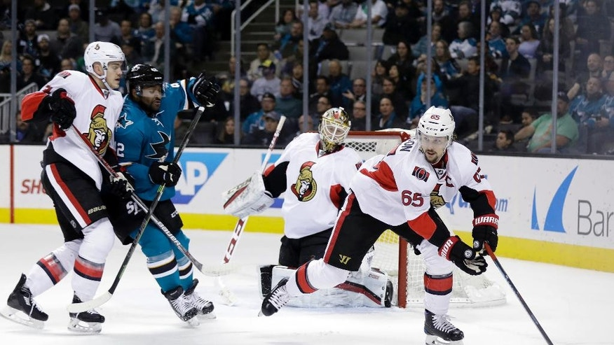 Ottawa Senators' Erik Karlsson (65) controls the puck against the San Jose Sharks during the first period of an NHL hockey game, Wednesday, Dec. 7, 2016, in San Jose, Calif. (AP Photo/Marcio Jose Sanchez)
