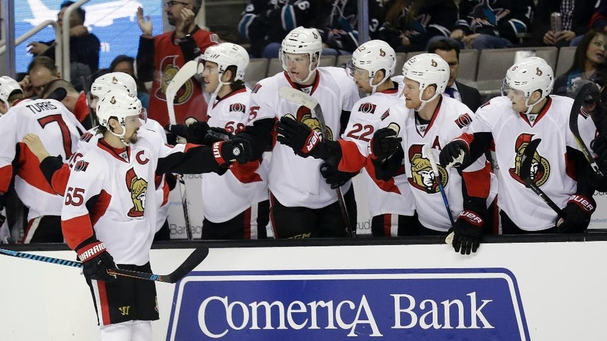 Ottawa Senators' Erik Karlsson (65) celebrates his goal against the San Jose Sharks during the first period of an NHL hockey game, Wednesday, Dec. 7, 2016, in San Jose, Calif. (AP Photo/Marcio Jose Sanchez)