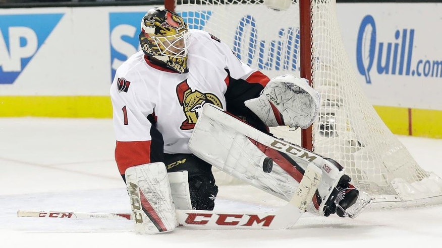 Ottawa Senators goalie Mike Condon (1) stops a shot against the San Jose Sharks during the first period of an NHL hockey game, Wednesday, Dec. 7, 2016, in San Jose, Calif. (AP Photo/Marcio Jose Sanchez)