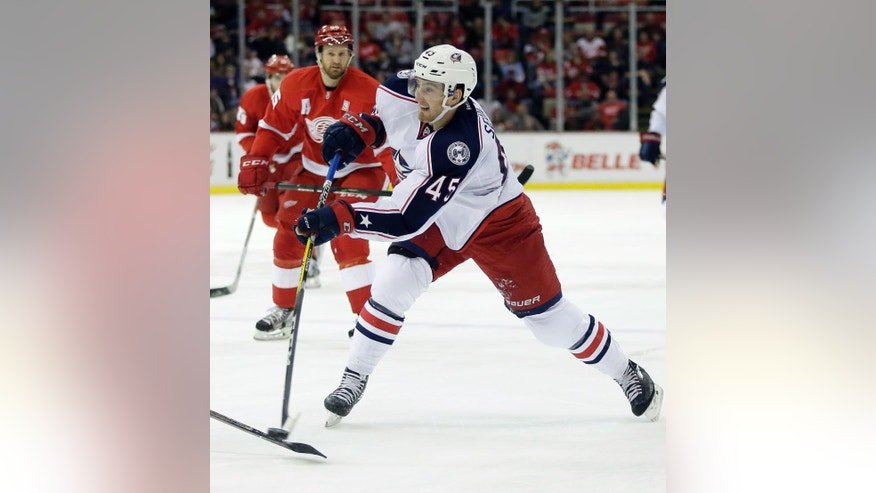 Columbus Blue Jackets center Lukas Sedlak (45), of the Czech Republic, takes a shot on goal against the Detroit Red Wings during the first period of an NHL hockey game Friday, Dec. 9, 2016, in Detroit. (AP Photo/Duane Burleson)