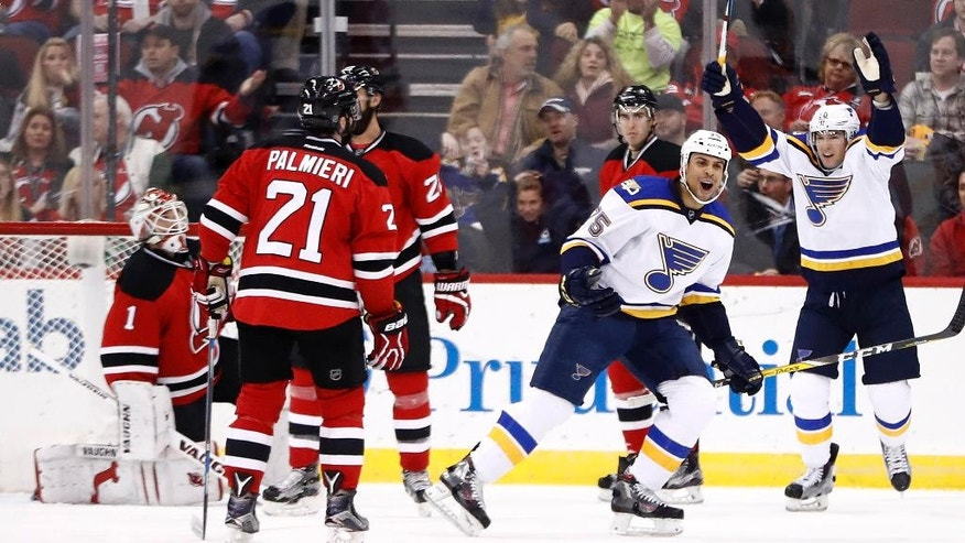 St. Louis Blues right wing Ryan Reaves, center, celebrates after scoring a goal on New Jersey Devils goalie Keith Kinkaid (1) during the second period of an NHL hockey game, Friday, Dec. 9, 2016, in Newark, N.J. (AP Photo/Julio Cortez)