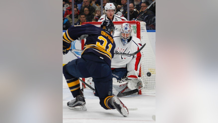 Buffalo Sabres forward Kyle Okposo (21) shoots the puck wide of Washington Capitals goalie Philipp Grubauer (31) during the first period of an NHL hockey game, Friday, Dec. 9, 2016, in Buffalo, N.Y. (AP Photo/Jeffrey T. Barnes)