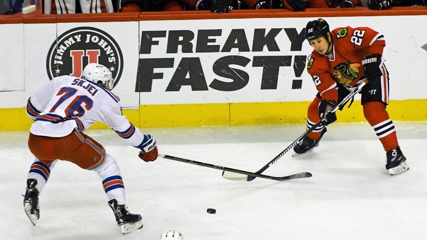 Chicago Blackhawks right wing Jordin Tootoo (22) passes against New York Rangers defenseman Brady Skjei (76) during the first period of an NHL hockey game on Friday Dec. 9, 2016, in Chicago. (AP Photo/Matt Marton)