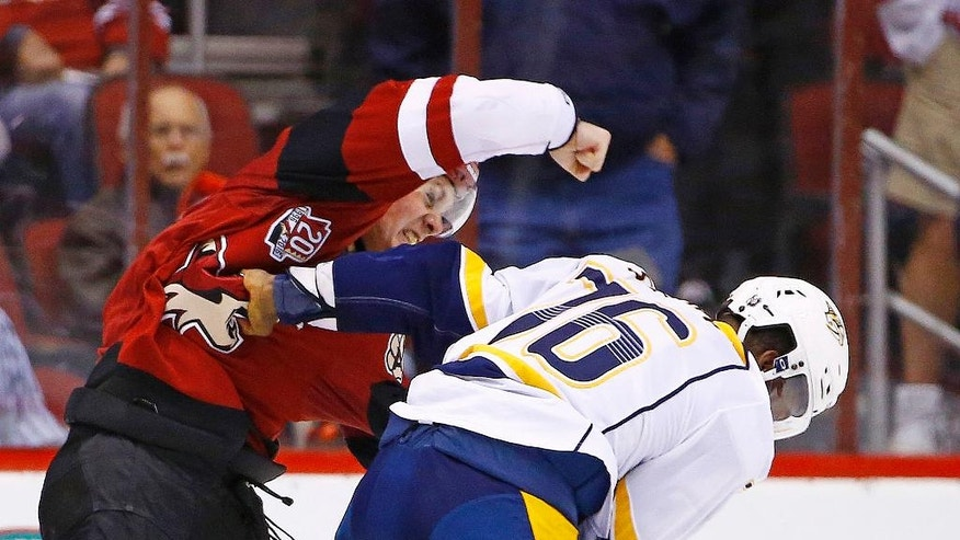 Arizona Coyotes left wing Lawson Crouse, left, throws a punch during a fight with Nashville Predators defenseman P.K. Subban (76) during the first period of an NHL hockey game Saturday, Dec. 10, 2016, in Glendale, Ariz. (AP Photo/Ross D. Franklin)