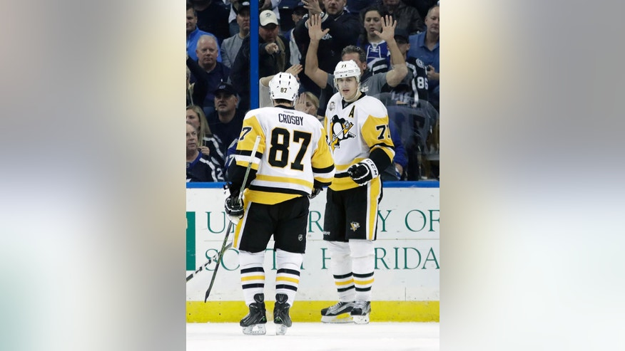 Pittsburgh Penguins center Evgeni Malkin (71), of Russia, celebrates his goal against the Tampa Bay Lightning with center Sidney Crosby during the second period of an NHL hockey game Saturday, Dec. 10, 2016, in Tampa, Fla. (AP Photo/Chris O'Meara)