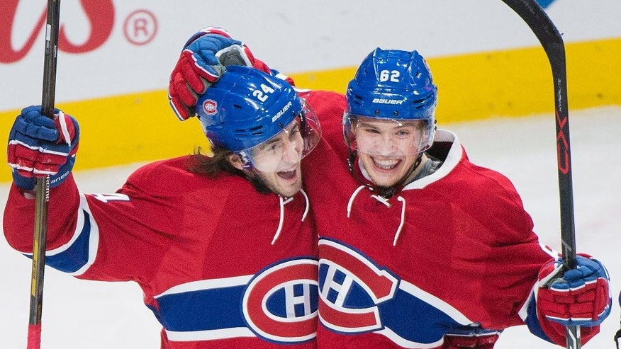 Montreal Canadiens' Artturi Lehkonen, right, celebrates with teammate Phillip Danault after scoring against Colorado Avalanche during first period NHL hockey action in Montreal, Saturday, Dec. 10, 2016. (Graham Hughes/The Canadian Press via AP)