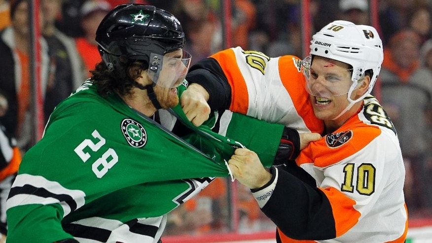 Dallas Stars' Stephen Johns, left, and Philadelphia Flyers' Brayden Schenn, trade punches during the second period of an NHL hockey game, Saturday, Dec. 10, 2016, in Philadelphia. (AP Photo/Tom Mihalek)
