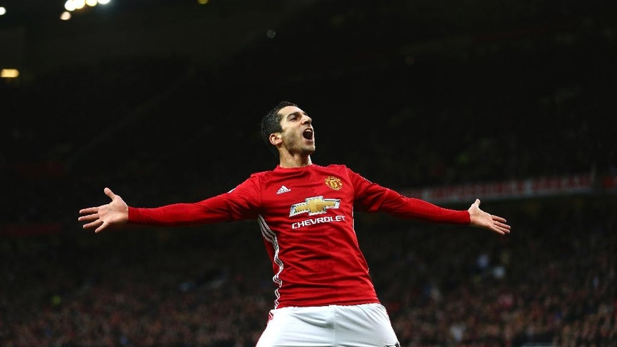 Manchester United's Henrikh Mkhitaryan celebrates scoring the first goal during the English Premier League soccer match between Manchester United and Tottenham Hotspur at Old Trafford in Manchester, England, Sunday, Dec. 11, 2016. (AP Photo/Dave Thompson)