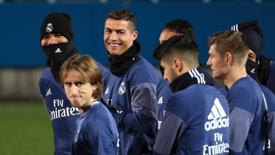 Real Madrid's Cristiano Ronaldo, rear center, and teammates warm up during a training session in Yokohama near Tokyo, Monday, Dec. 12, 2016.  Real Madrid and Mexico's Club America will play in the semifinal of the FIFA Club World Cup soccer tournament on Dec. 15. (AP Photo/Koji Sasahara)